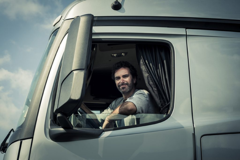 truck-driver-sitting-in-cab