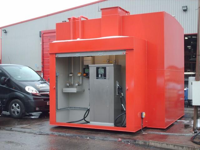 Fueltek fuel pump in a red custom made fuel filling station