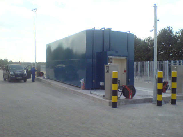 Fueltek FT4000AP with a 130,000 litre fuel storage tank in the background