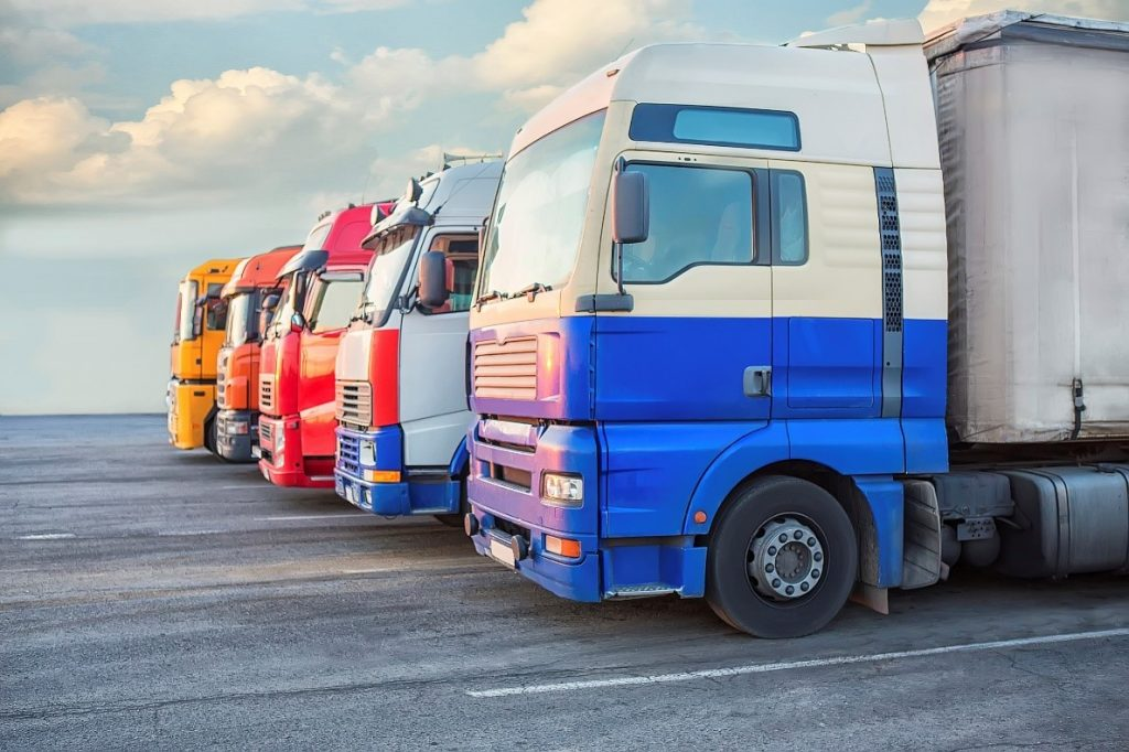 Colourful fleet of commercial trucks lined up ready to set off